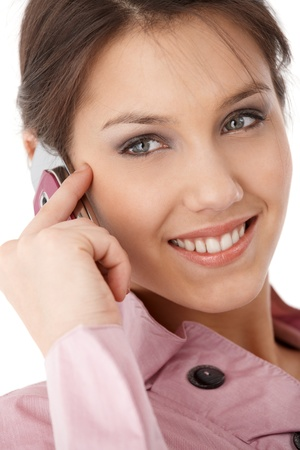 attractive young businesswoman chatting on mobile phone, smiling.%uFFFD photo