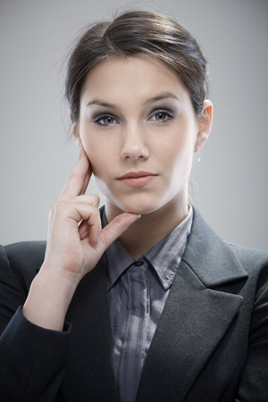 unsmiling: Portrait of confident young businesswoman, thinking. Stock Photo