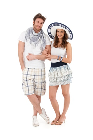 Portrait of happy young couple in summer outfit, looking at camera, smiling, isolated on white background. photo