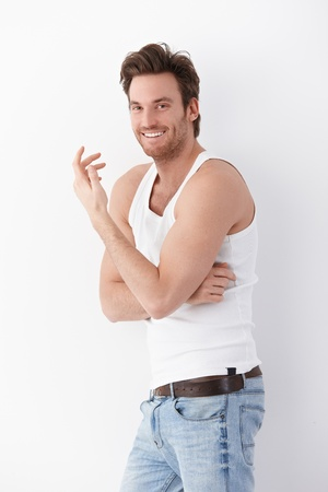 stockphoto: Vital young man smiling happily at camera.