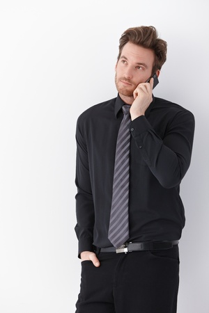 Handsome young businessman talking on mobile phone. Stock Photo - 9435072