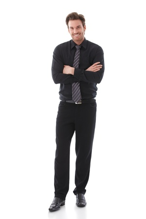 Confident businessman standing arms crossed, smiling. Stock Photo - 9434555