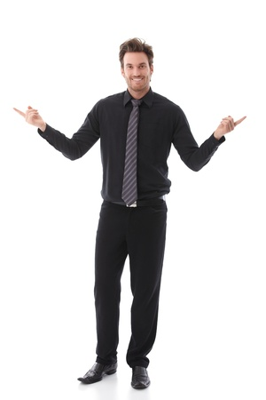 right hand: Smiling businessman pointing to left and right sides. Stock Photo