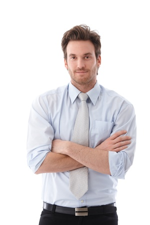 casual caucasian: Casual young businessman standing arms crossed, smiling. Stock Photo