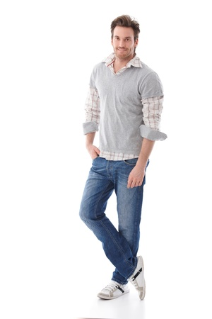 jean pocket: Casual young man in jeans and shirt smiling.