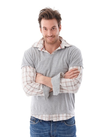 Casual young man looking questioningly at camera, smiling. Stock Photo - 9434888