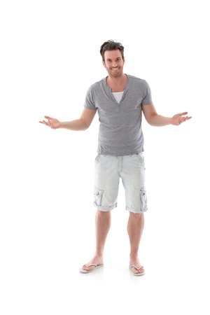 male arm: Handsome young man standing arms wide open, smiling at summertime. Stock Photo