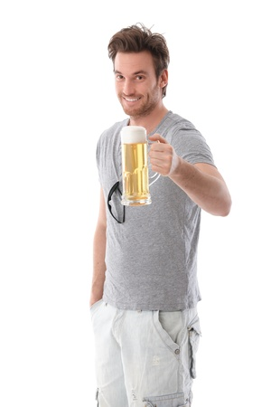 Handsome young man drinking beer, smiling.