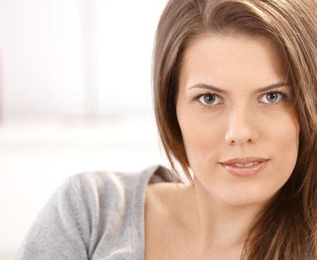 Closeup facial portrait of young attractive woman smiling at camera. Stock Photo - 9434788