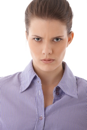 Angry strict woman portrait, looking at camera upset and serious. photo