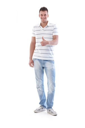 Successful young man smiling with thumb up. Stock Photo - 9537991