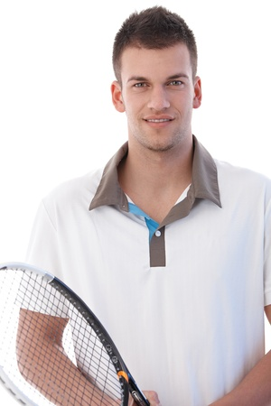 Portrait of handsome young male tennis player, smiling. photo