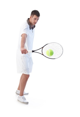 stubbly: Young tennis player prepared for backhand stroke.