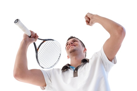 Young tennis player happy for scoring, clenching fists, holding tennis racket. photo