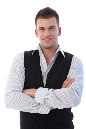 Confident young businessman smiling arms crossed. photo
