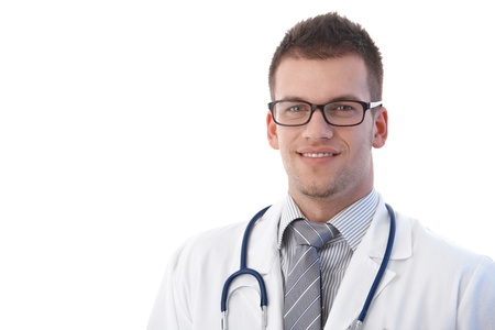 Portrait of happy young medical student smiling at camera. photo