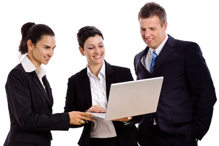 attire: Happy young businesspeople looking at laptop computer screen, laughing. Isolated on white.