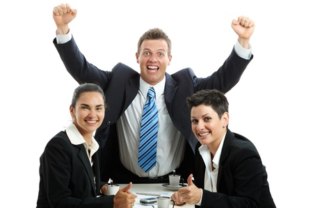 interacting: Happy business team celebrating business success at coffee table, isolated on white.
