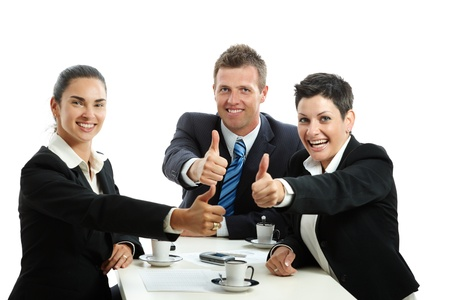 mediation: Happy business team having a meeting at coffee table, showing OK with thumbs up. Isolated on white. Stock Photo
