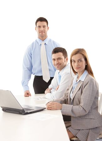 Portrait of young successful businesspeople working together, smiling. photo