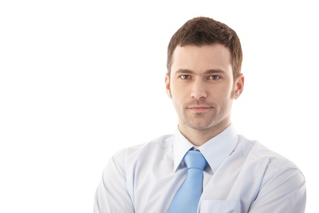 Portrait of confident young businessman over white. Stock Photo - 9537983