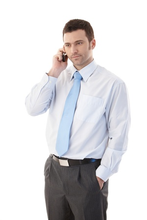 Young casual office worker talking on mobile phone. Stock Photo - 9538090