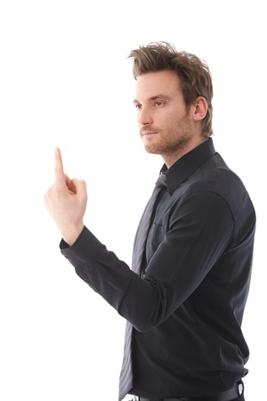 Handsome young businessman balancing an invisible object on his forefinger. Stock Photo - 9538049