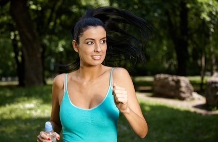 citypark: Attractive young woman training in citypark.