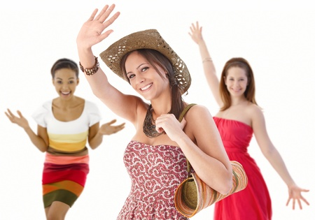 have on: Group of happy young women waving hands in summer dresses.