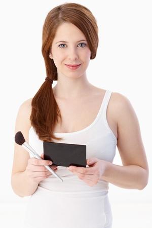 gingerish: Fresh ginger-haired woman prepared for applying makeup, smiling.