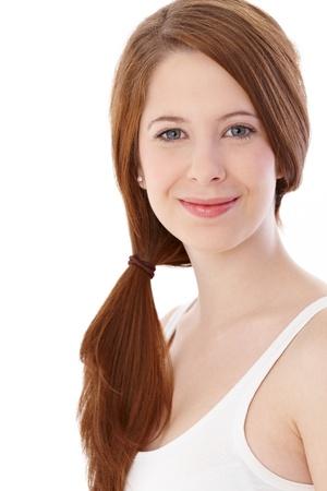 gingerish: Natural young gingerish woman smiling at camera. Stock Photo