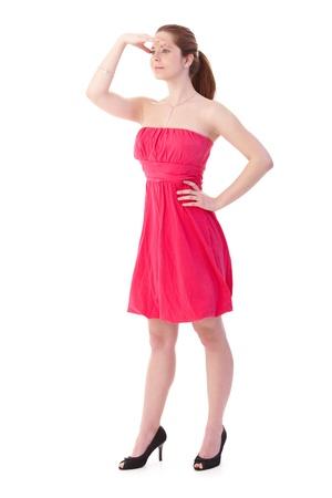 gingerish: Gingerish mujer mirando a distancia, con vestido rosa bastante y zapatos de tac�n. Foto de archivo