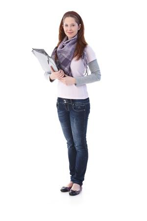 gingerish: Pretty college student holding folders, smiling. Stock Photo
