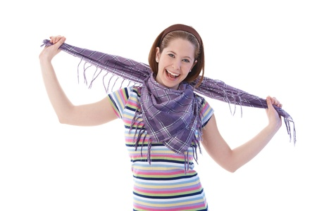 gingerish: Young girl in scarf and t-shirt smiling happily at camera.