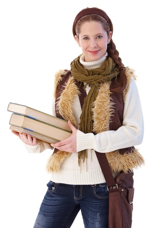 Pretty college student going to school, holding books, smiling at camera. Stock Photo - 9564119