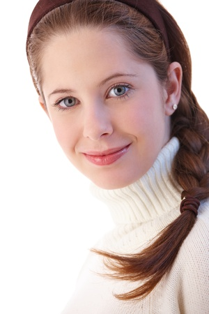 Portrait of beautiful young girl smiling at camera. photo