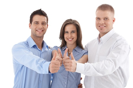 team spirit: Young successful businessteam giving thumb up, smiling, team spirit, isolated on white.