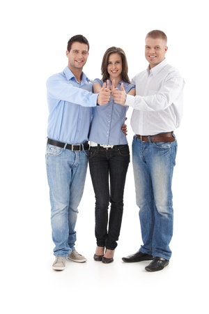 doing business: Cutout portrait of successful business group standing in huddle, doing thumb up, smiling. Stock Photo
