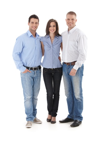 3 persons: Young casual office team standing together, smiling at camera, cutout portrait.