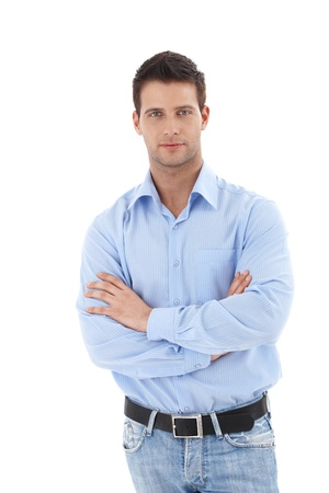 1 person only: Studio portrait of handsome casual man standing with arms folded, looking at camera, isolated on white.