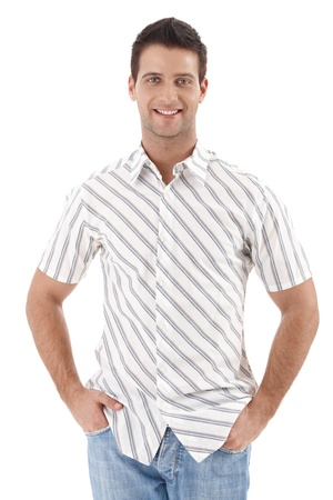 good shirt: Happy handsome man standing in summer shirt with hands in pocket, smiling at camera, isolated on white.