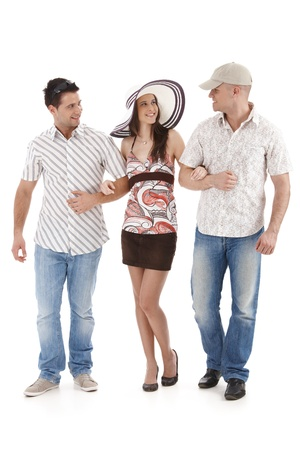 Group of friends walking together, wearing summer clothes, smiling, cutout on white. Stock Photo - 9563225
