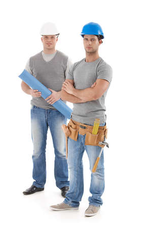 severity: Engineer and handyman in protective hat, looking at camera, isolated on white, full size. Stock Photo