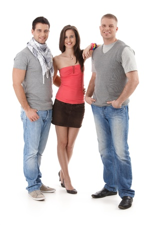 three persons: Summer portrait of trendy college student friends standing together, smiling, looking at camera. Cutout, full length.
