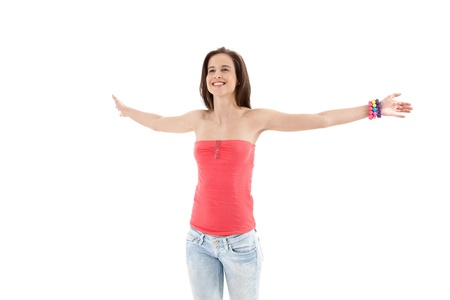 Laughing trendy girl standing with arms wide open happily, cutout on white background. photo