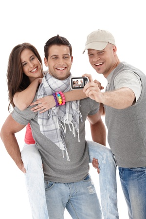Good friends enjoying taking picture of themselves, laughing, isolated on white background. photo