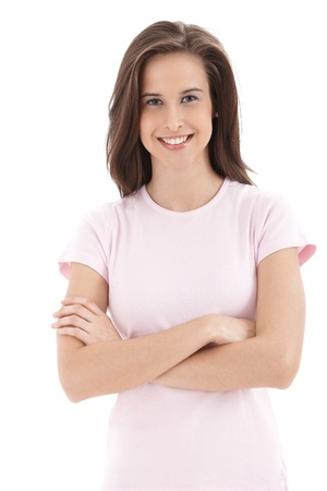 Confident college student girl smiling into camera with arms folded, isolated on white. Stock Photo - 9562476