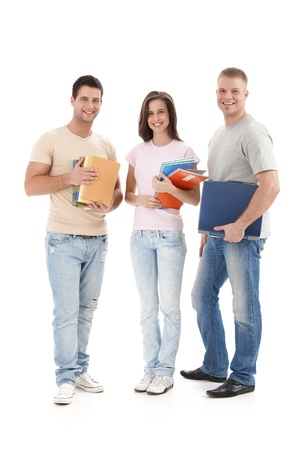 Happy university students standing with books and notes handheld, smiling at camera, cutout. Stock Photo - 9562472
