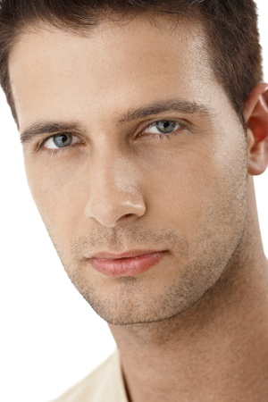 1 adult only: Closeup portrait of handsome young man looking at camera confidently. Stock Photo