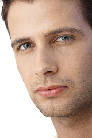 20s  closeup: Closeup portrait of handsome guy looking serious at camera. Stock Photo